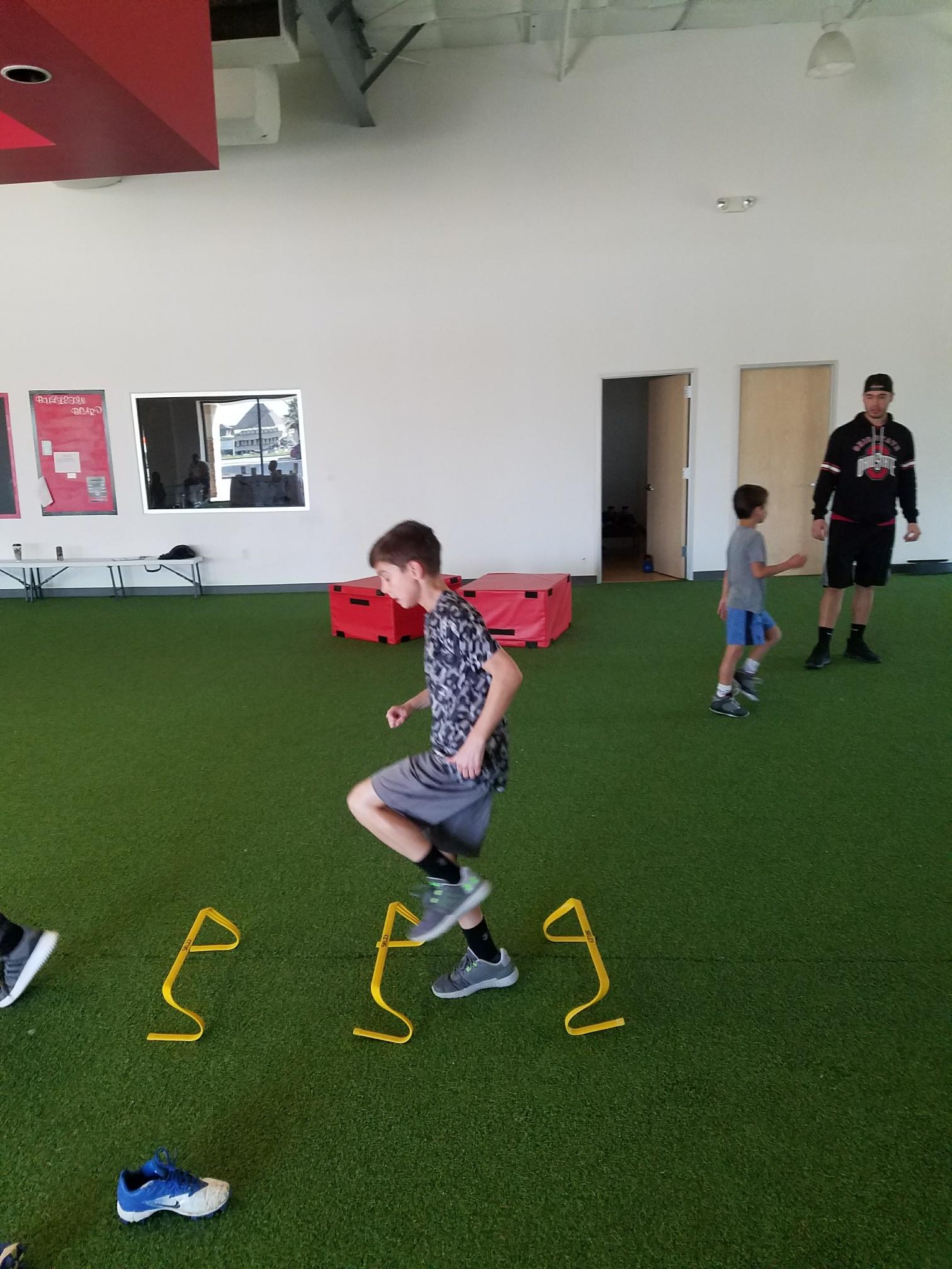 Circuit Training. Utilizing the speed hurdles in this picture!